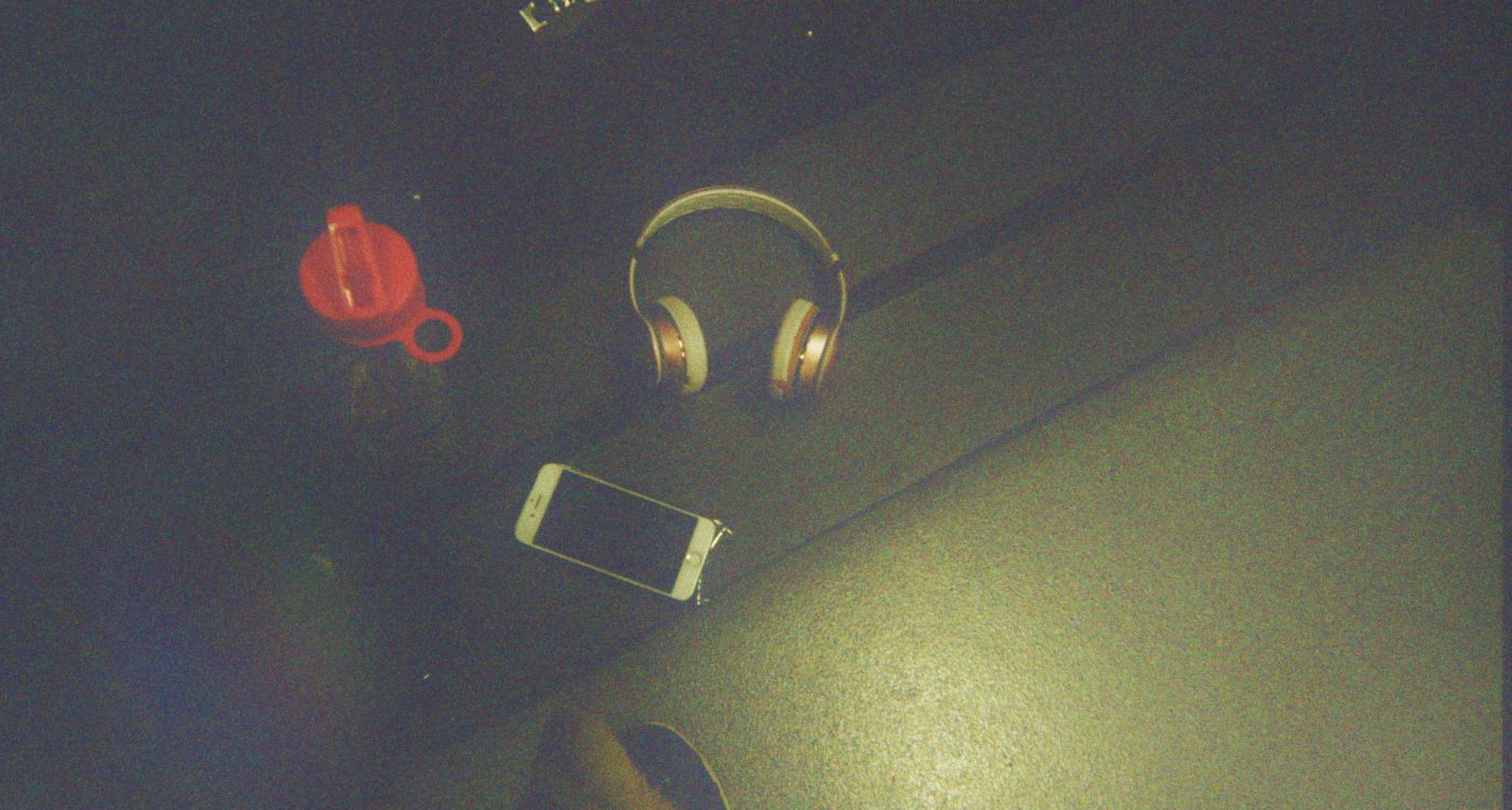 Abbi's photograph (for the 21st Century Kids) of her headphones a bottle of water and her phone.