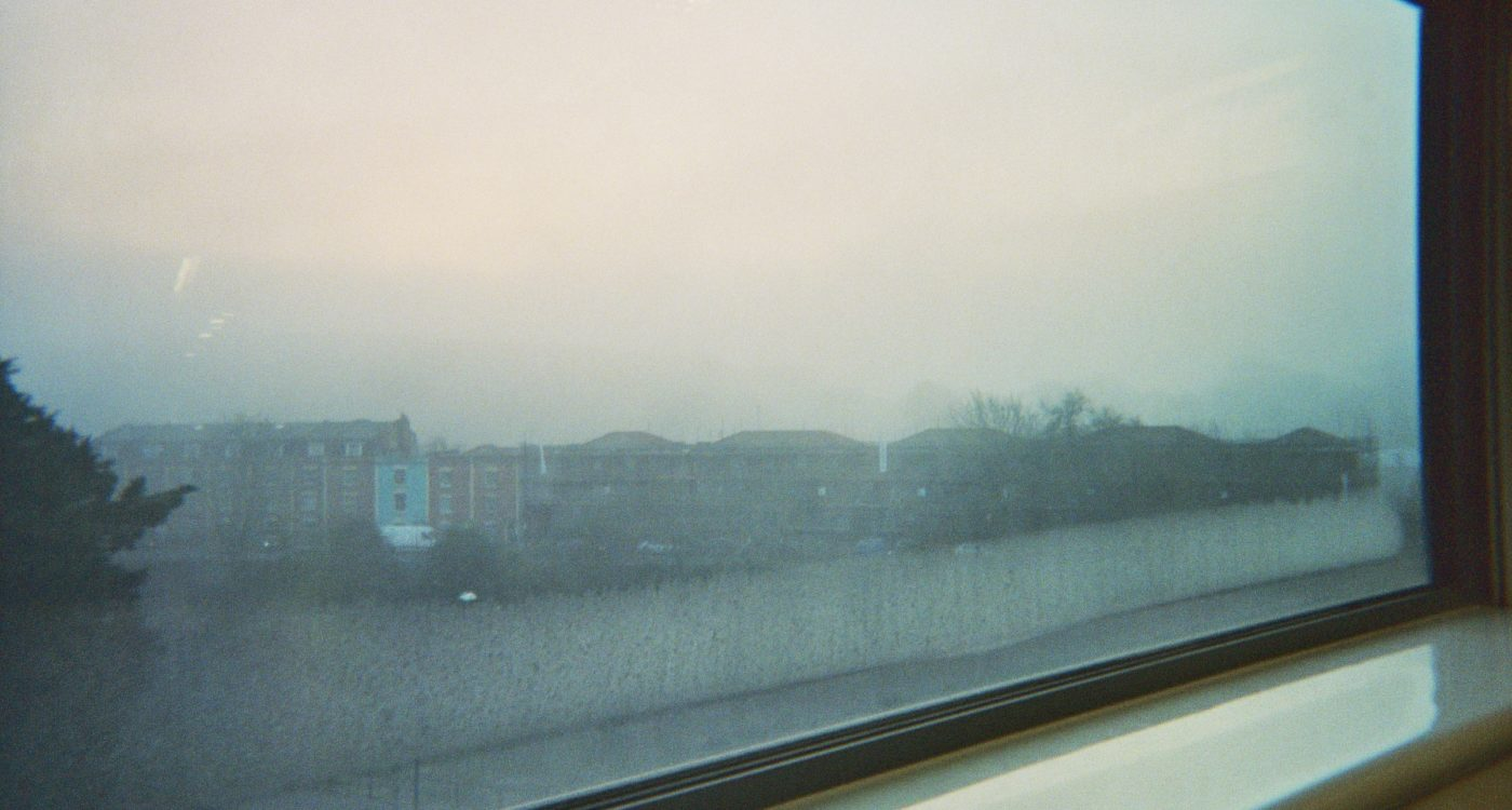 Damien's photograph (for the 21st Century Kids) of outside his school window. There are terrace houses and looks quite foggy.