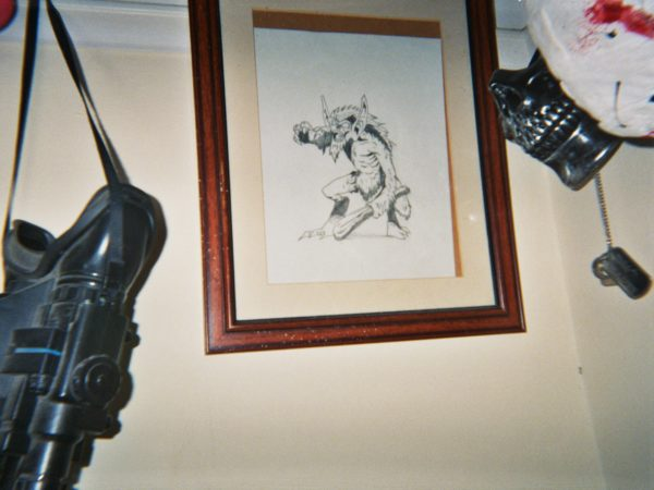 Fred's photograph (for the 21st Century Kids) of a framed pencil drawing of a mythical creature (looks like a goblin with a club in its hands)