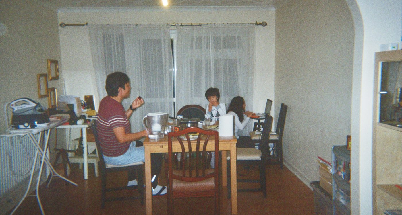 Beatriz's photograph (for the 21st Century Kids) of her family sitting down for dinner