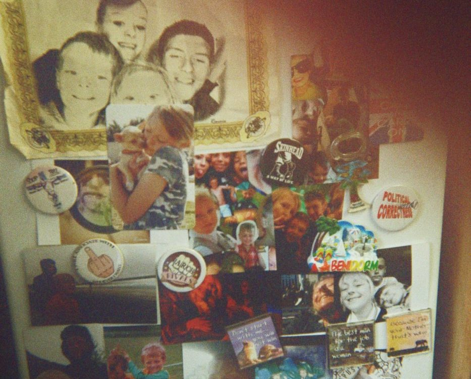 Damien's photograph (for the 21st Century Kids) of his fridge covered in photographs and fridge magnets.