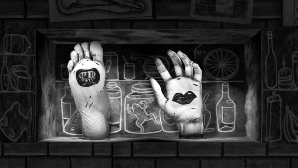 A black and white drawn image which shows a severed hand and foot in front of a line drawing of bottles and jars.