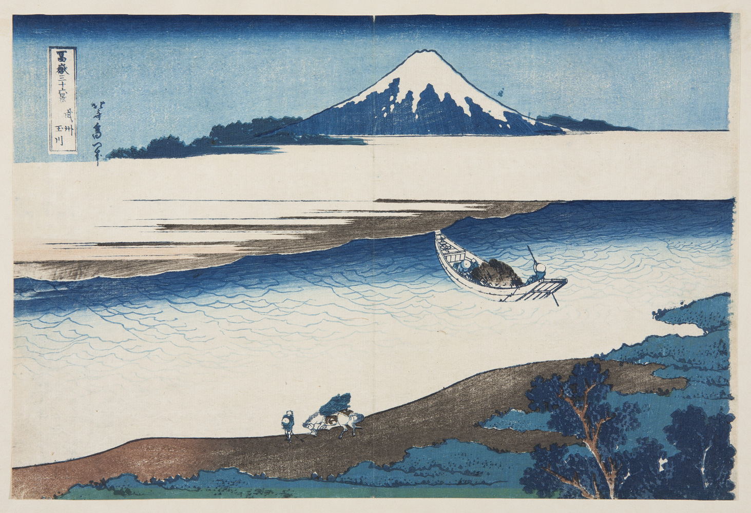 Japanese print of a landscape. A boat sails on the river. In the foreground a figure walks along the bank with a horse. Mount Fuji rises up in the background.