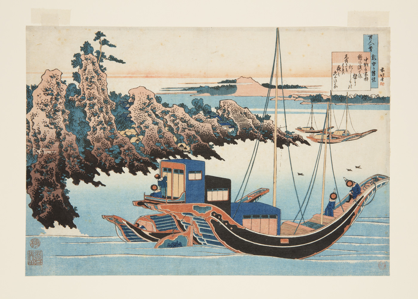 Japanese print of a seascape. Boats sail on the water, the coast is mountainous and wooded.