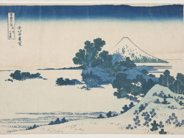 Japanese print of a landscape with hills, villages, forests leading to Mount Fuji in the background.