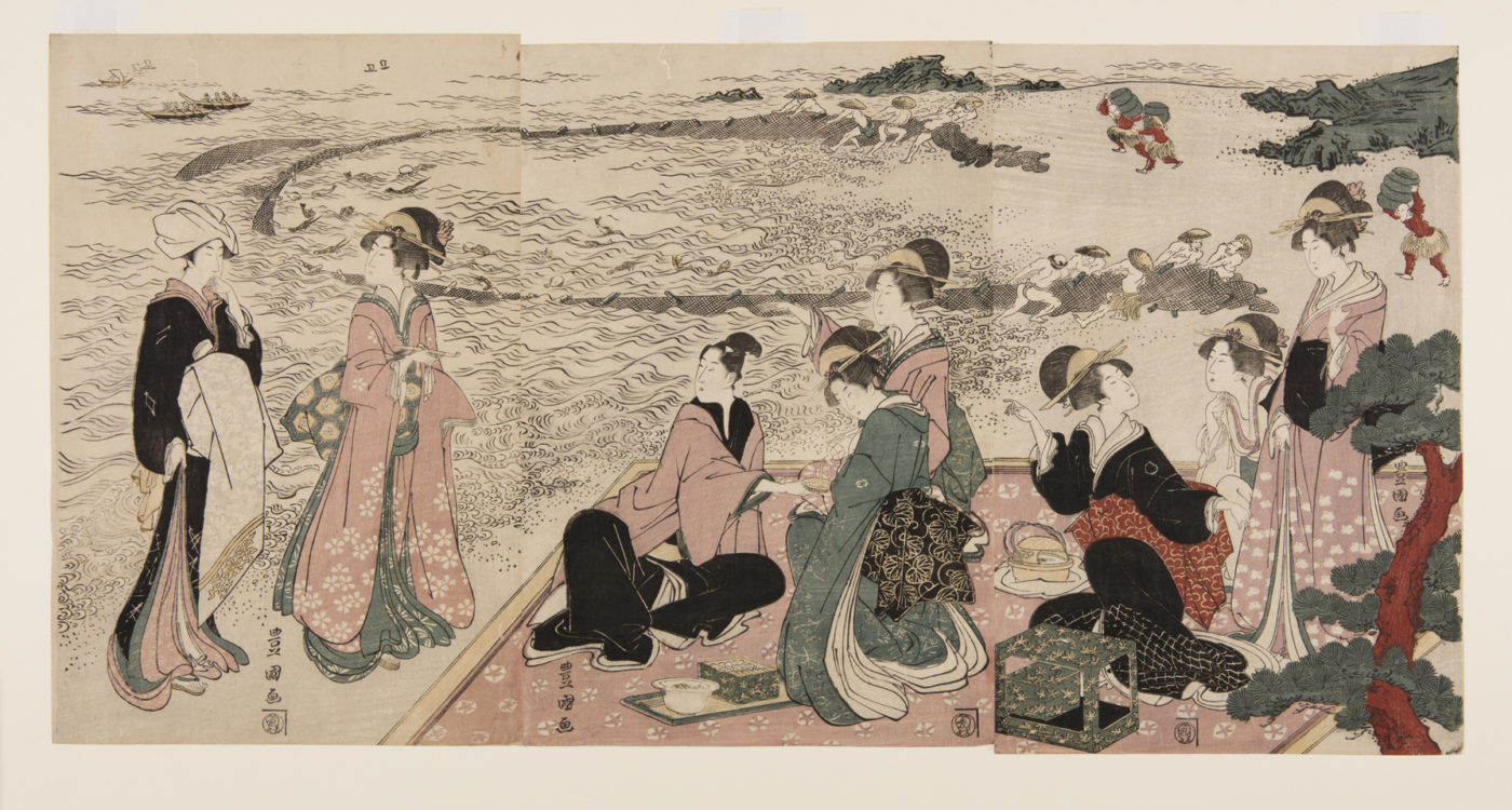 A Picnic on the Seashore, Japanese print of a group of people dressed in elaborate traditional clothes seated and standing on a picnic mat.