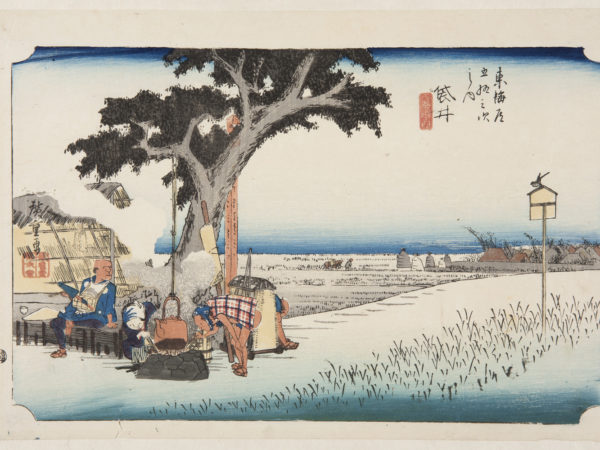 japanese print of a landscape with flat rice fields in the background. in the foreground, a kettle of tea heats up on a fire in front of a tree. a man is stooping down taking a drink of tea while a woman tends to the fire. another man rests on a bench
