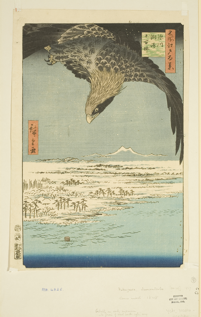 Japanese print. A large bird of prey, flies at the top of the print, wings outstretched and looking at the landscape below, of sea, land and distant mountains.