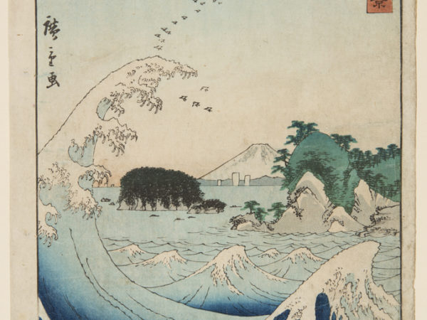 Japanese print of a landscape. In the foreground is the sea and a large wave curls over. Middle distance are wooded islands and a mountain. A flock of birds fly high in the sky..