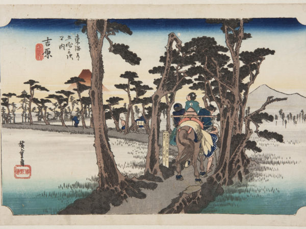 japanese print of travellers on a horse walking through a road lined with trees which zig zags through a marshy area. there are mountains in the background