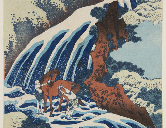 Japanese print of a waterfall descending from the top, through a wooded and rocky landscape. In the water stands a horse and two old men washing it.
