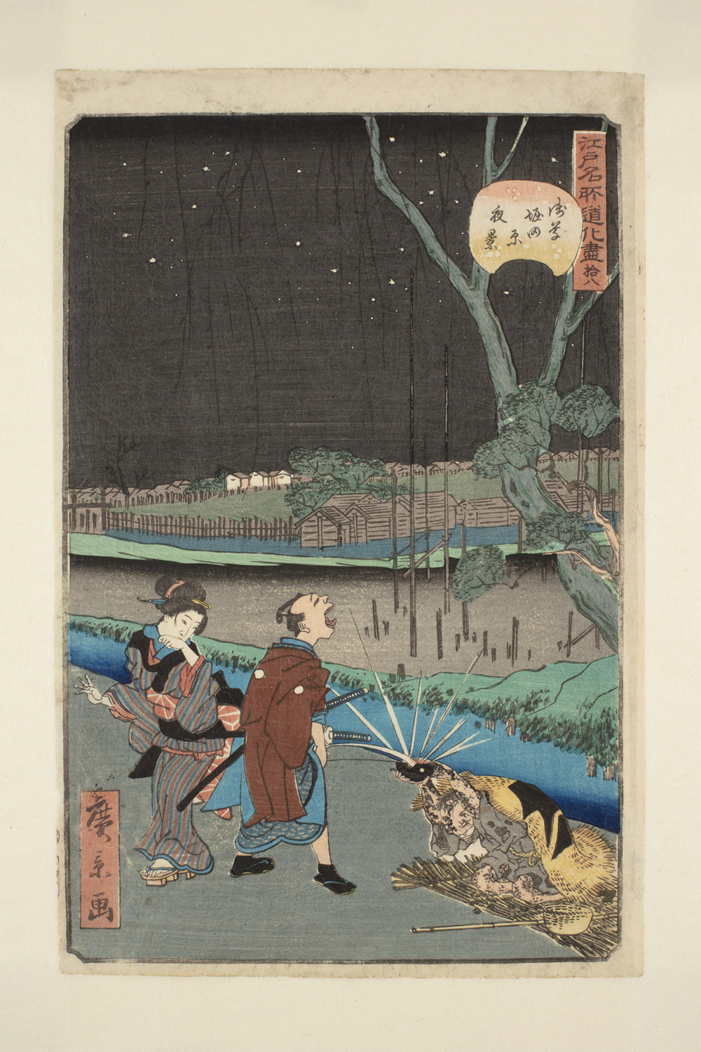 Japanese print. A man and a woman standing by a stream dressed in traditional clothes. The man is shouting at a lantern caught in the tree. There are buildings and stars in the night sky in the background.