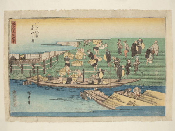 Japanese print of a harbour scene. A boat is moored at the quay and men are unloading it and carrying bundles of cargo up the steps behind.