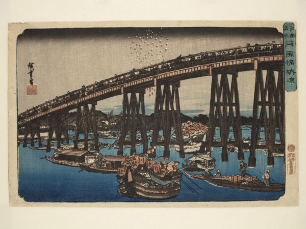 Japanese print of a river scene. Several boats sail under the wooden struts of the bridge above. People can be seen walking over the bridge.