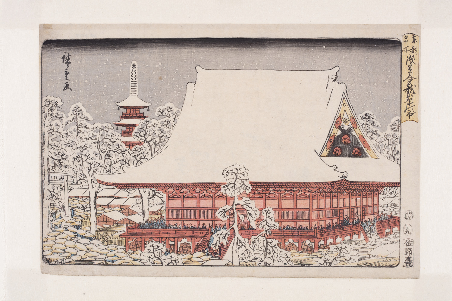 Japanese print of a large traditional Japanese building with snow on the roof. From the veranda many small figures can be seen looking out at the garden. The trees are covered with snow and walking through them we can see many small figures with their opened umbrellas. In the background there is a tall tower.