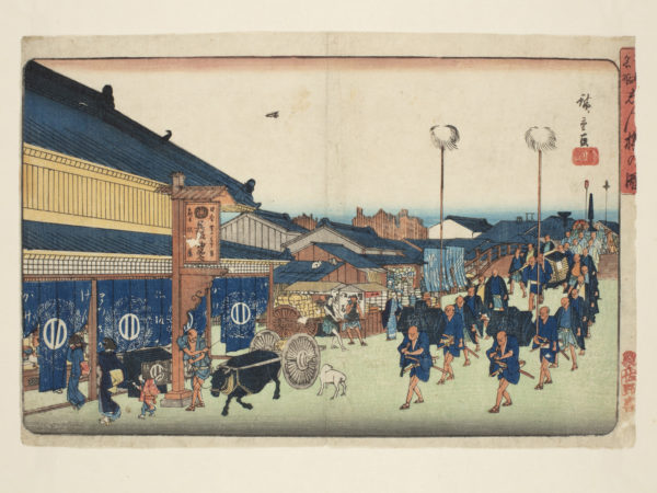 Japanese print of a procession along a street, with buildings and the sea on the horizon. In the foreground is an ox pulling a cart with a driver by its side, behind men, in rows, carry trunks on their backs, others carry tall poles, the procession recedes back over a bridge and into the distamce.