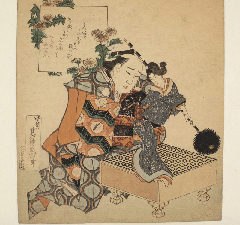 Japanese print of a man, in traditional robes, kneeling at a table, He is holding a puppet of a woman dressed in a kimono.