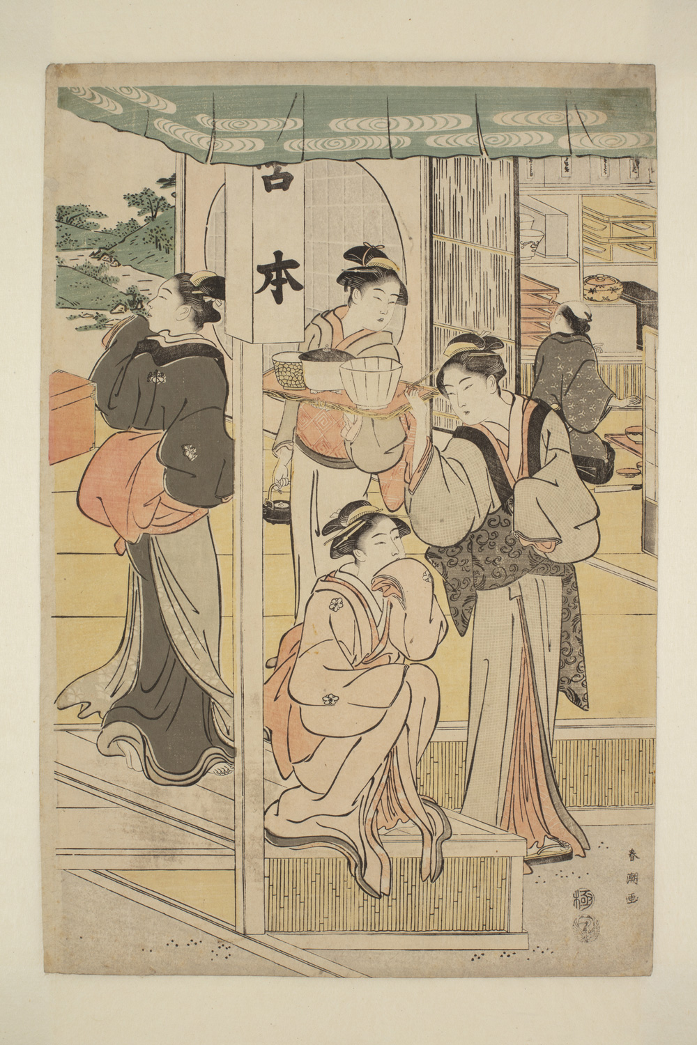 Japanese print of a group of women dressed in traditional clothes. One women stands and looks outside. Another is crouching down with a third standing and looking at her. Behind them another woman holds a tray with three bowls on it. At the back of the room are shelves and a figure looking at them.