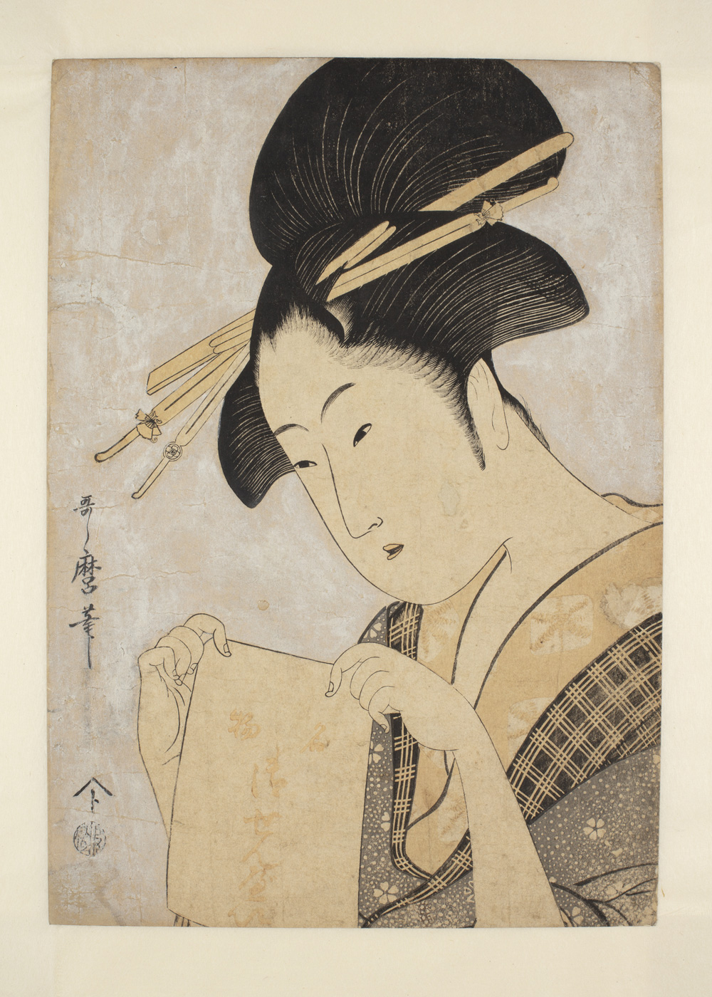 Japanese print of a woman dressed in traditional clothes holding a paper bag with Japanese text.
