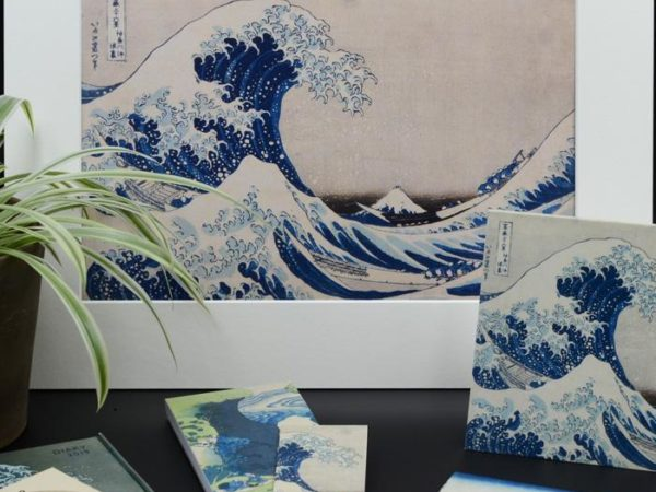 Selection of merchandise with the image of Hokusai's Great Wave including; prints, coasters and note pads
