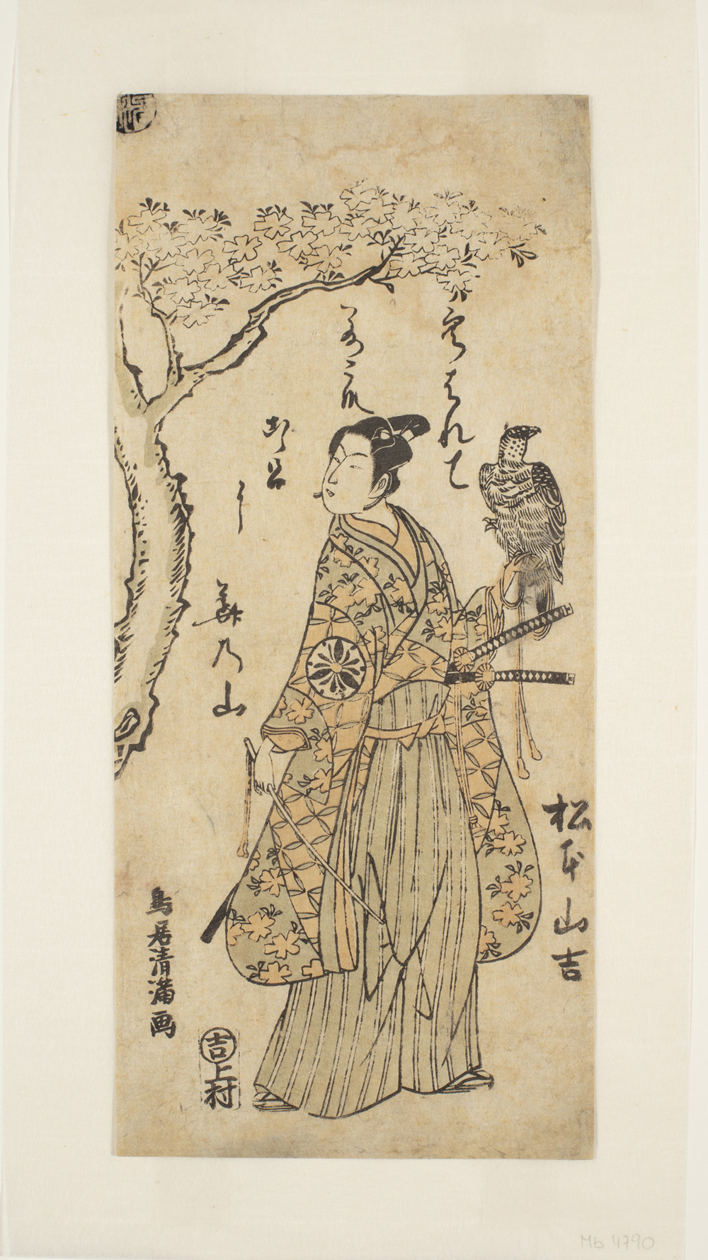 A Japanese print of an actor dressed in traditional robes by a tree. Two swords are visible and he holds a bird of prey on his left arm.