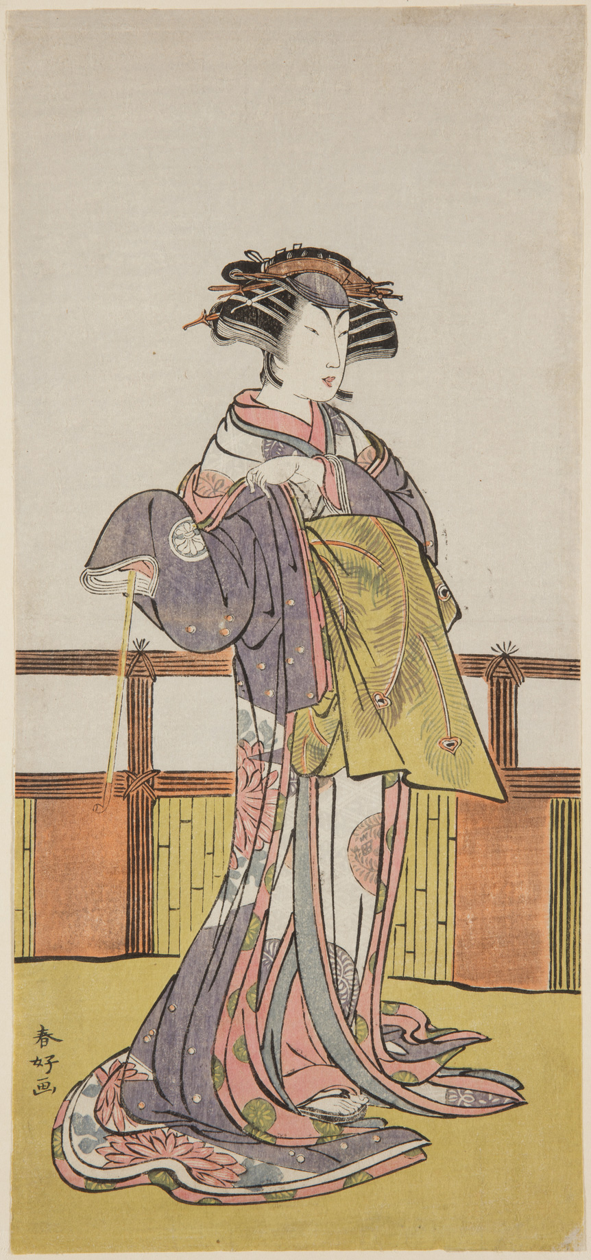 A Japanese print of an actor standing with one hand holding the sleeve of the long flowing traditional robes.