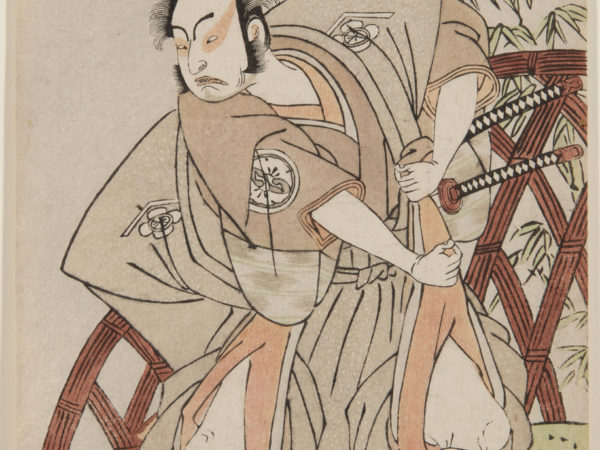 A Japanese print of an actor stood in a dramatic pose in samurai costume.