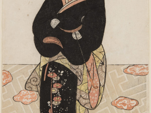 A japanese print of an actor dressed in a black kimono, arms folded and looking to the side.
