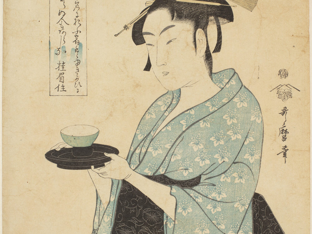 Japanese print with of a woman wearing traditional clothes, light blue with white flowers and black sash. She is holding a small bowl on a small tray. Japanese text either side of the figure.