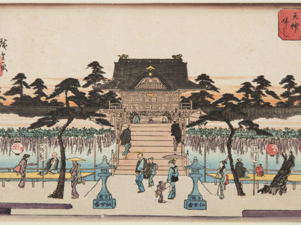 Japanese print of a garden scene. People, dressed in traditional clothes stroll or sit on platforms next to displays of hanging wisteria, steps lead up to a grand building behind.