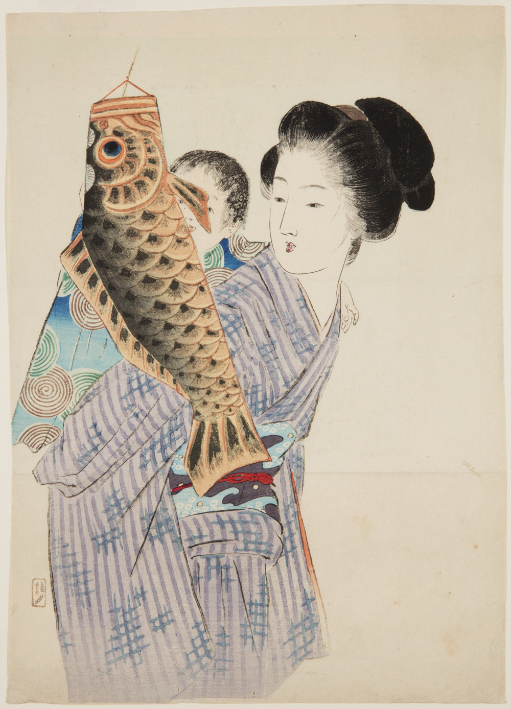 Japanese print of a woman dressed in traditional clothes and a baby on her back., the child gazes at the carp shaped toy he is holding.