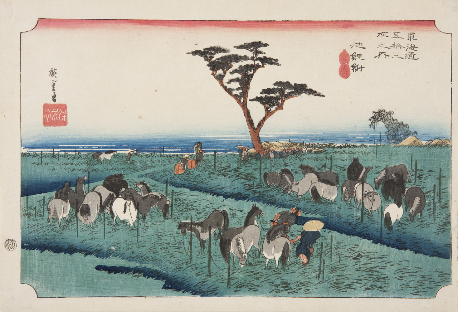 Japanese print of a landscape. Many horses are tied up to posts in a field and men tend to them. A tree is in the centre and behind it we see buildings and a huddle of people.