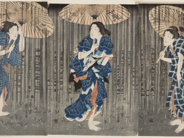 Japanese print of three people dressed in traditional clothes and bare feet standing on the grass, they clutch umbrellas against the rain.