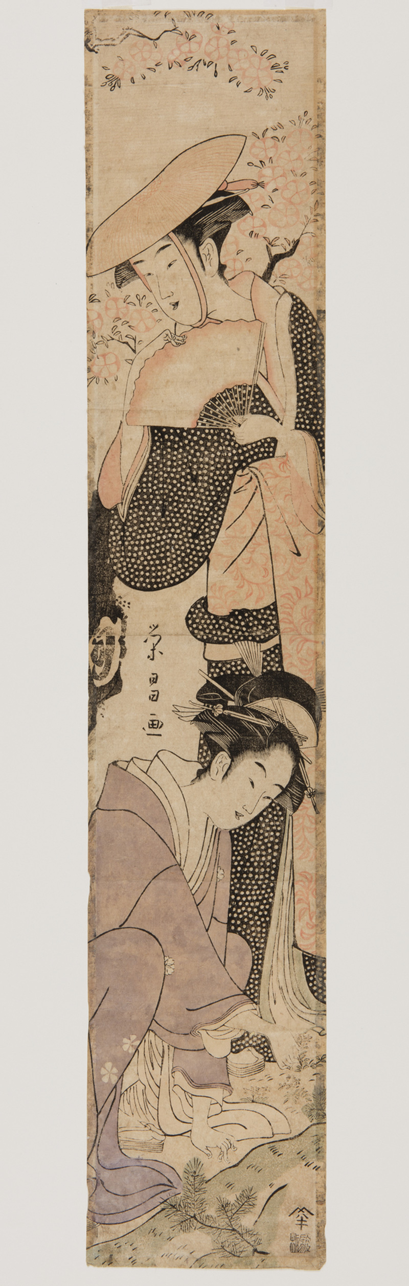 Japanese print of two women dressed in traditional clothes, one standing, one kneeling.