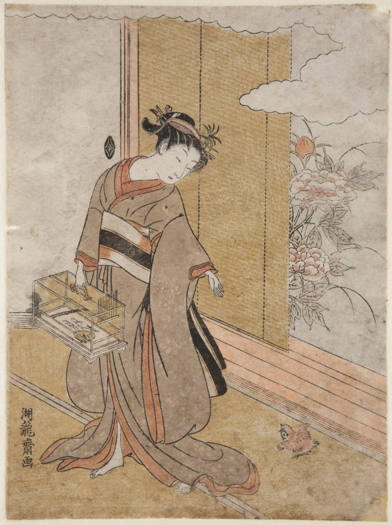 Japanese print of a woman dressed in traditional clothes holding a cage, she looks down at a small bird sitting on the floor next to an open door with a garden outside.