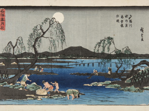 Japanese print of a river scene, fishermen dressed in loin cloths and traditional clothes, stand on the banks with baskets, others wade and bend over in the water, In the distance is a bridge, mountains and a full moon.
