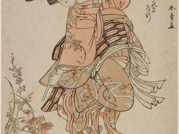 Japanese print of an actor dressed in elaborate traditional clothes standing by some flowers.