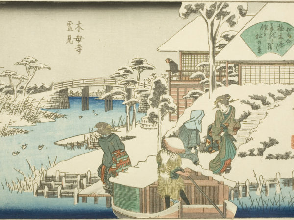 Japanese print of a snowy scene, a boatman moors his boat and passengers get off dressed in traditional costume, behind is a building and a man looks out from the balcony over the river and the bridge in the background.