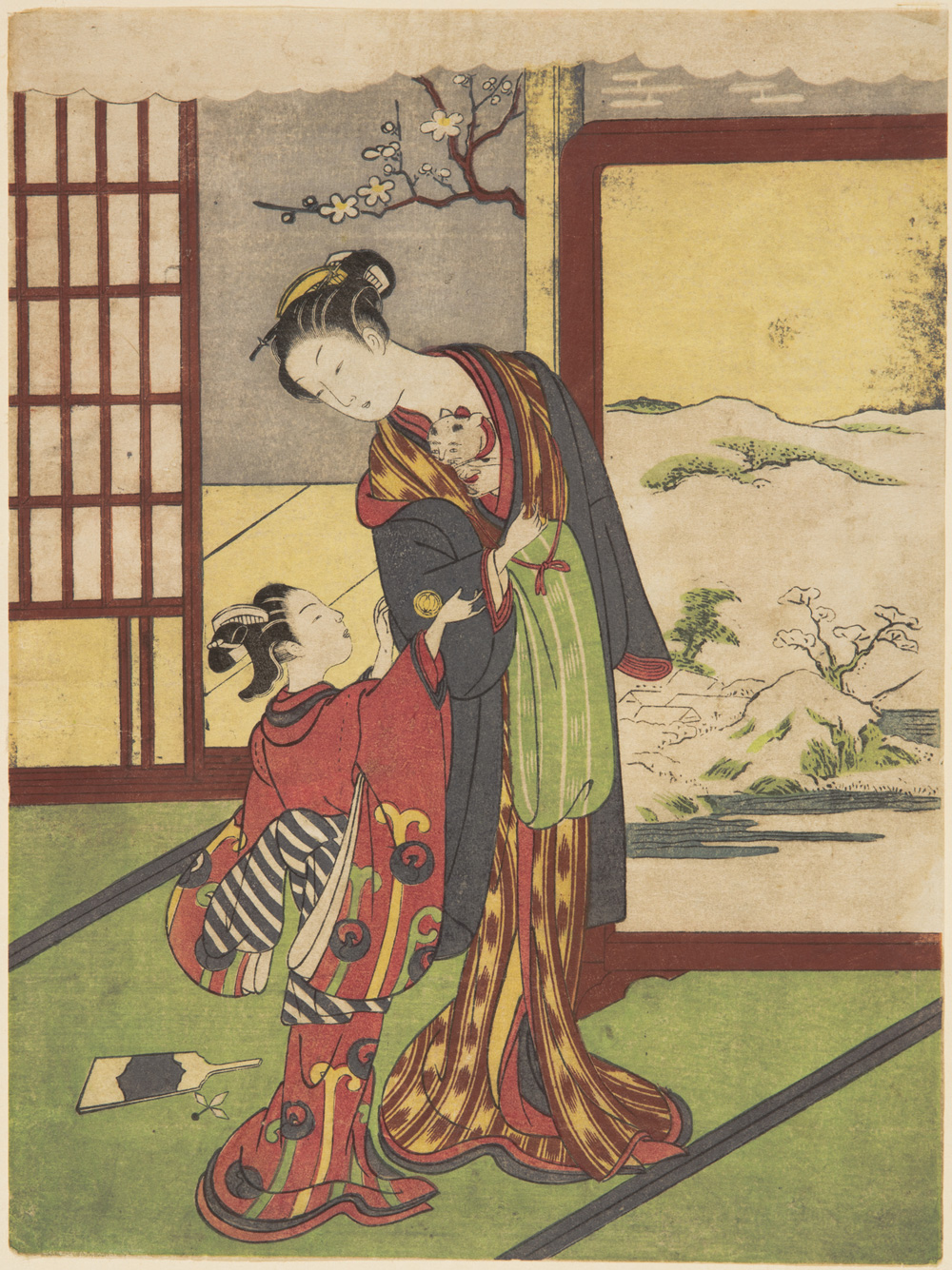 Japanese print of a woman and a child dressed in traditional clothes, the child reaches up to a kitten the woman holds in her kimono, we see a landscape through the door behind them.