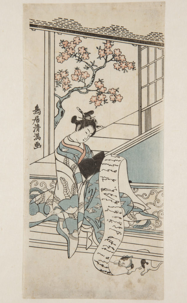 Japanese print of a woman dressed in traditional clothes, she sits by a window with blossom outside, and reads a long scroll of paper, a cat playfully grabs the paper from under the bench.