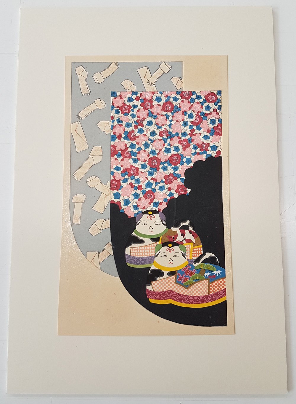 Print of two kimono designs one with white motifs the other with flowers and two colourful cat like creatures.