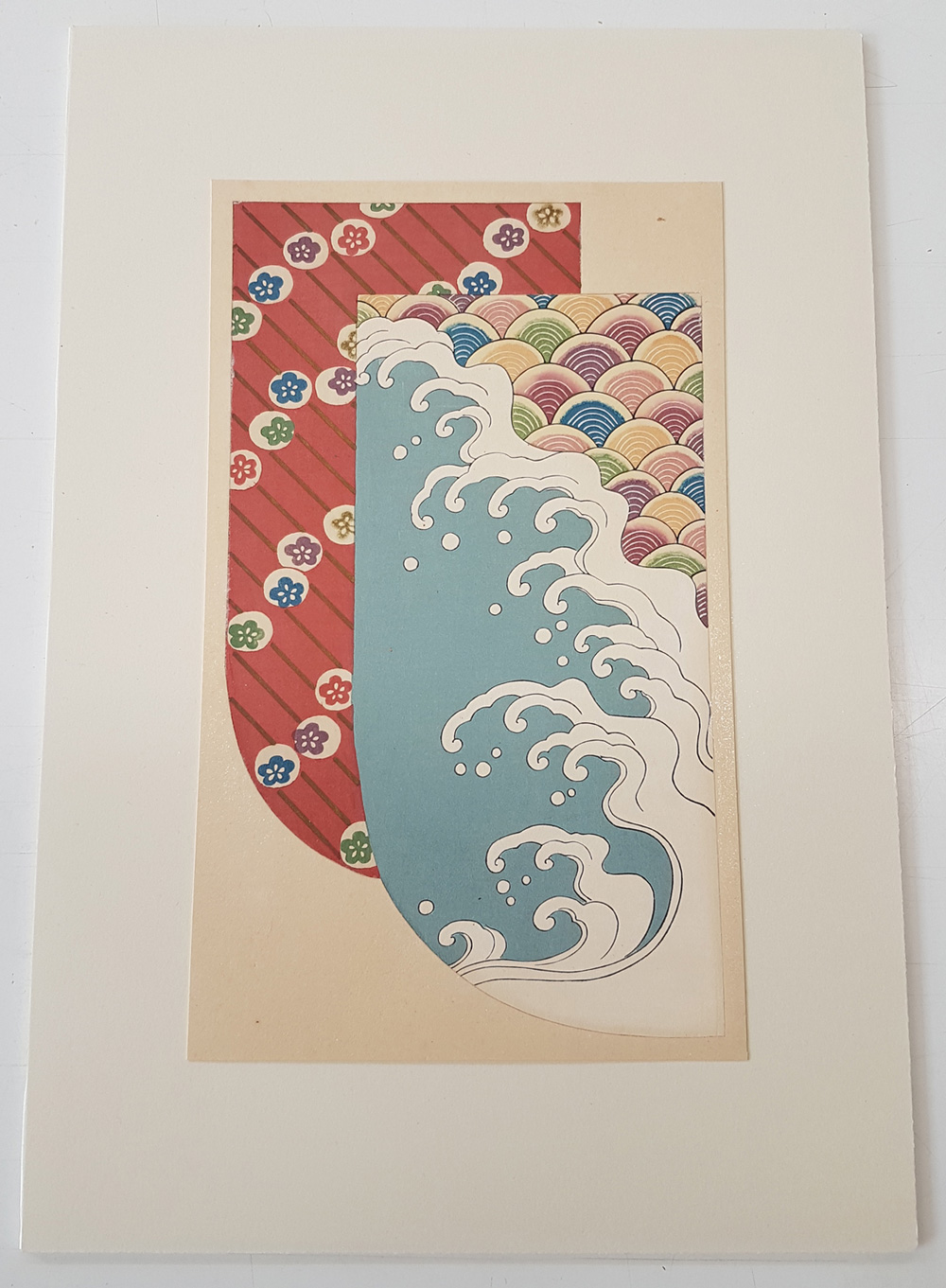 Image of two kimono designs one of small flower motifs the other of the sea and crashing waves.