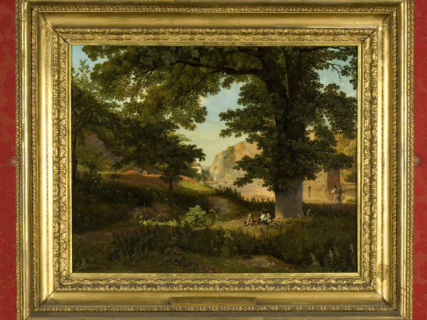 Painting of woodland scene with rock
