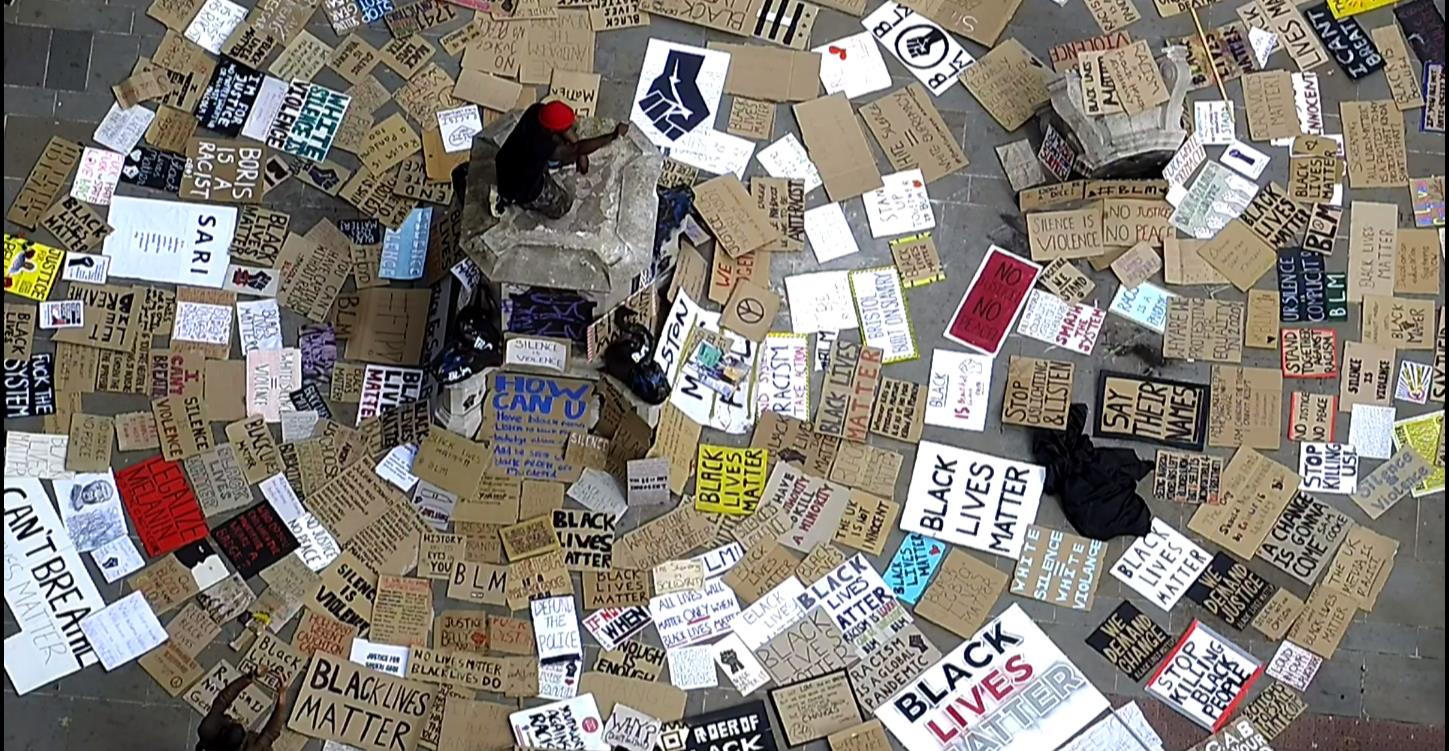 Placards left at the plinth of the Colston statue (©Bristol City Council)