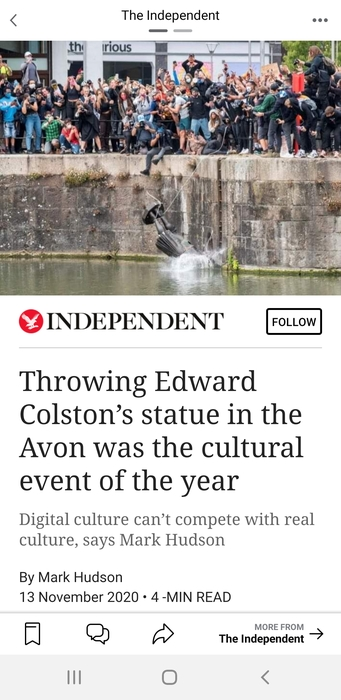 Screenshot of the Independent newspaper online. Photo shows a statue hitting the harbour water, surrounded by a large crowd of people above. Headline reads 'Throwing Edward Colston's statue in the Avon was the cultural event of the year'.