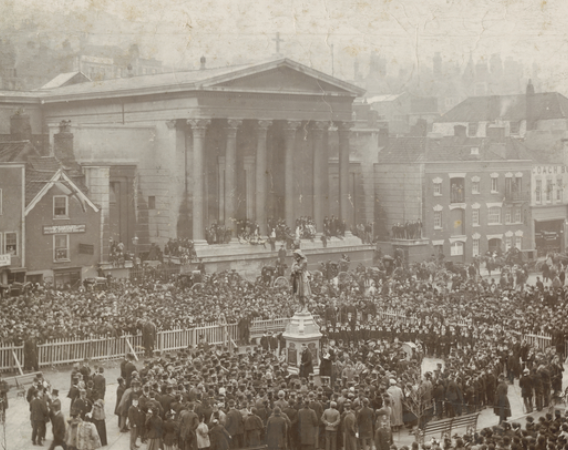 Small sepia image of the opening ceremony of the statue of Colston. Large crowd of people surround the statue, with some areas barriered off.Opening ceremony of the statue of Colston (© Bristol Archives)